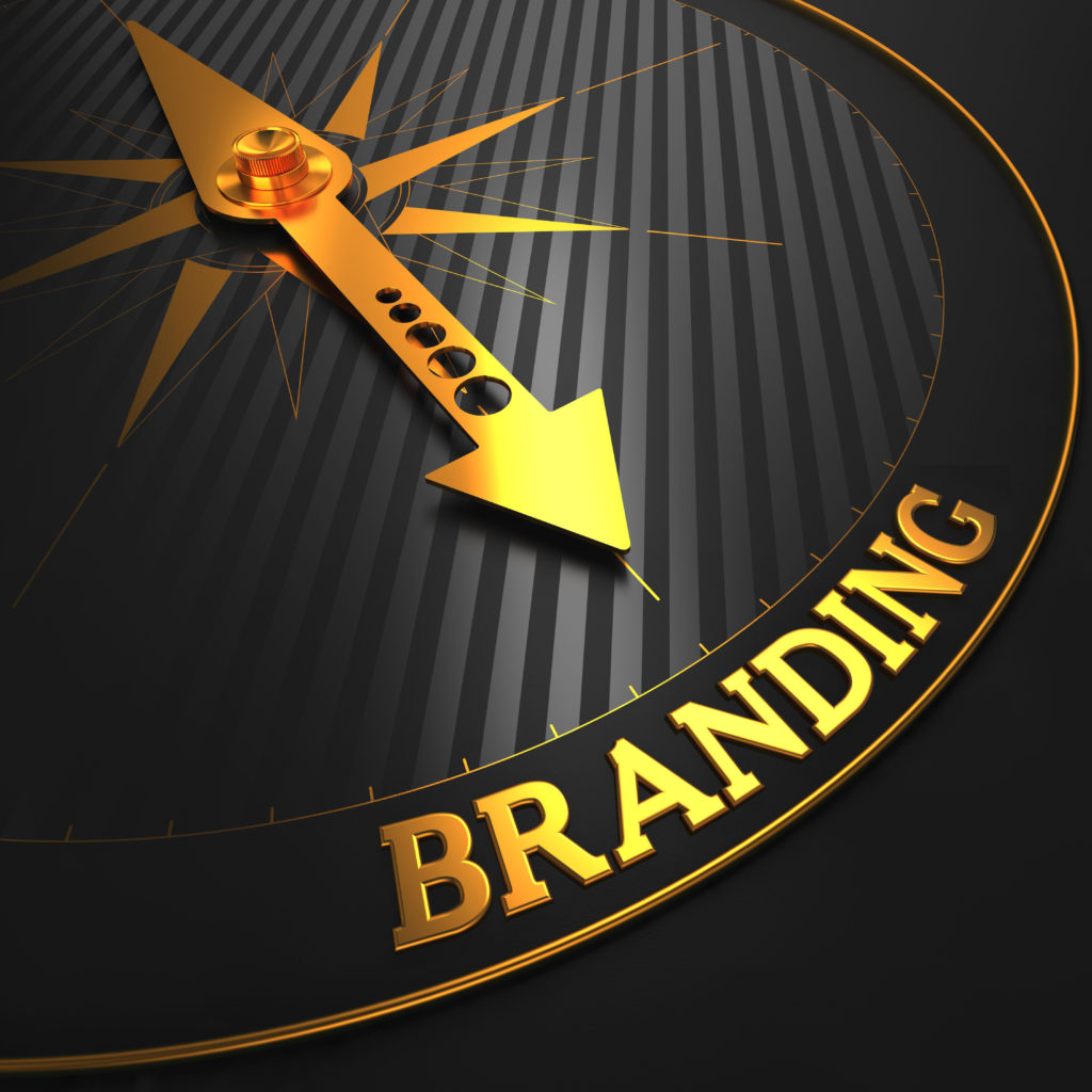 """Branding - Business Concept. Golden Compass Needle on a Black Field Pointing to the """"Branding"""" Word."""